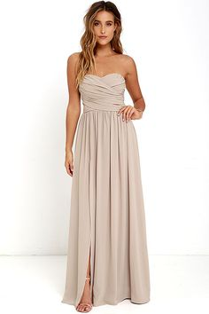 You'll be admired as soon as you set foot in the party wearing the Moonlight Serenade Taupe Strapless Maxi Dress! Draping woven poly fabric adorns a strapless sweetheart neckline with lightly padded cups and no-slip strip. A gathered waist introduces a full, maxi skirt with sexy side slit. Hidden back zipper and clasp…