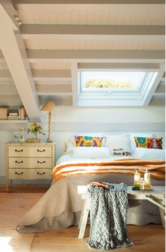 Attic bedroom with skylight.  The more I see these the more I want one some day.