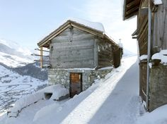 the update of an old barn in the alps features new openings with a renovated interior that is possibly more stunning than the views.
