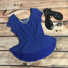 Striped Peplum Shirt Stripes + Peplum = Awesomeness! This shirt is 21 1/2 inches long in the front and 25 inches long in the back with a high-low hem. The waist is 12 inches and it's very stretchy with a low back. Dress it up or down and it'll look great. Xhilaration Tops