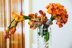 Suhaag Garden, Indian wedding decorator, Florida wedding decorator, vase, crystal beads, calla lillies, orange flower bouquet