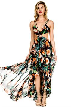 HOLY CHIC! We are absolutely crazy in love with this stunning maxi dress! Our Electric Feel maxi dress features a bold tropical print with side cutouts, halter neck and open back. We cannot wait to we