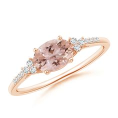 Something new to the old style jewelry. Horizontally Set Oval Morganite Solitaire Ring with Trio Diamond Accents