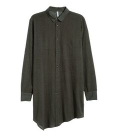 Long shirt in crinkled cotton with a narrow turn-down collar, long sleeves and an asymmetric hem.