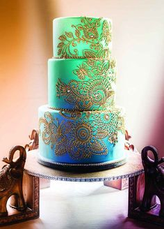 17 unique wedding cake ideas: Ombre Indian Inspired Wedding Cake. Cake by Artisan Cake Company. http://www.colincowieweddings.com/food-and-drink/17-wedding-cakes-that-will-make-you-forget-all-other-cakes