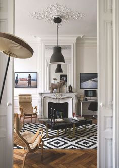 Southern Home Decor Parisian living room with modern black pendant light via CoteMaison Arnaud Caffort.Southern Home Decor Parisian living room with modern black pendant light via CoteMaison Arnaud Caffort