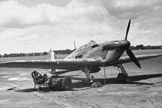 RAF Hawker Hurricane with ground crew and starter 1940.