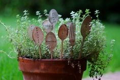 Old silverware upcycled into garden markers