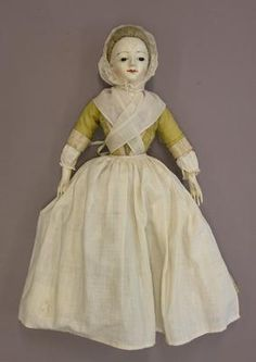 Title	Doll wearing pocket Collection	Victoria and Albert Museum Date	mid-1700s Main Image View	Doll wearing pocket