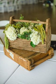 Floral centrepiece displayed in a wooden crate box.