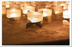 Votive place-settings. (Guests can take them home and they make the whole room brighter!)