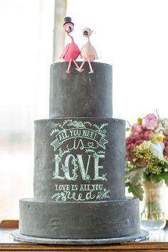 Fabulous chalkboard wedding cake with flamingo toppers!