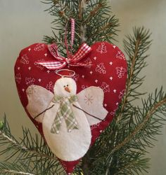Snow Happy Hearts Club.  Bunny Hill's snowman's heart of the month pattern.  Here is January's.