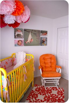Love the pompoms and LOVE the yellow crib.  Maybe we'll paint the crib for the next baby...