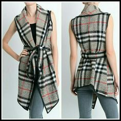 The Plaid Vest in size S and M Beautiful plaid vest in Grey,  black,  and red Nwot,  can be worn with long sleeve top or tunic Material is Acrylic and wool  Sizes S and M No Trade Discount on bundles Price Firm unless bundled boutique  Jackets & Coats Vests