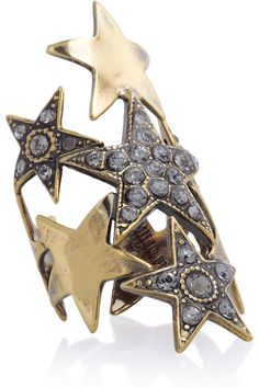 After-dark looks will instantly twinkle when you add Emilio Pucci's crystal-embellished star ring. With its eye-catching celestial motif, this piece promises to make a statement whether worn with either monochrome or color-blocked outfits.