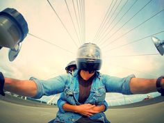 Photo of Patrick Bross and his lady love Maria crossing the Arthur Ravenel Jr. Bridge in Charleston, South Carolina. Patrick mounted his GoPro camera on the gas tank of his motorcycle with the Suction Cup mount. Awesome angle captured handsfree! http://shop.gopro.com/mounts/suction-cup/AUCMT-302.html#/start=1