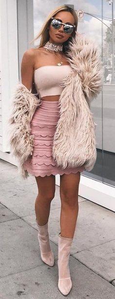 how to wear a pair of velvet boots : crop top + mini skirt + pink fur coat