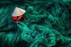 """Location: Vietnam """"In a small village in southern Vietnam near Phan Rang, a woman wearing a typical ... - Courtesy SIPA"""