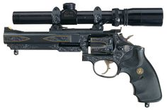 gunrunnerhell:  Custom Smith & Wesson Model 17-5 Engraved and gold inlaid revolver, that in spite its size and intimidating appearance is actually chambered in .22 LR. The engraver, Jere Davidson is well known in the knife community but he has done engraving work on guns for many years. Well known engravers can add quite a bit of value to a gun but generally it takes a period of time. (GRH) Source