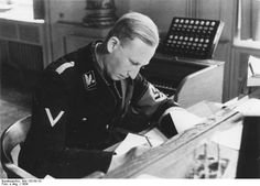 Reinhard Heydrich working overtime to keep everything straight for future treasure hunters, Berlin, 1934
