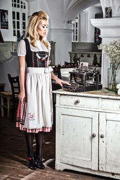 Oh oh oh. And look at the details, retro hair, shoes, high closed blouse. Dirndl by Jan&Ina