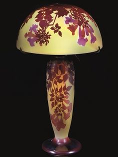 DOUBLE OVERLAID CAMEO TABLE LAMP, circa 1905, glass, overlaid and acid-etched. H: 62.2cm. Cameo mark Gallé to the shade, intaglio mark Gallé to pedestal. This was sold at GBP 24,500 in April 2008, Christie's.
