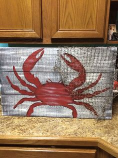 Crab painted on pallet boards