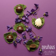 This blooming praline in dark chocolate has 2 layers; a ganache with violets from Toulouse and crispy praliné with Italian meringue. #neuhaus #chocolate #duopralines