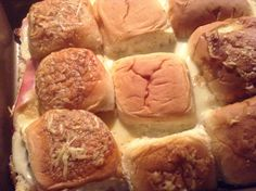 Tailgate Sliders:  Ham, cheese, Hawaiian rolls, cream cheese (we used onion and chives.  Guys gave it 2 thumbs up.  I give it 1 because they are messy and not something I would want a bunch of rowdy football fans running around the house with.  Cut rolls in half, place bottom half in pan, layer ham, then cheese. Spread cream cheese across bottom of top half and lay on rolls.  Cover and bake at 350 for 25 minutes.