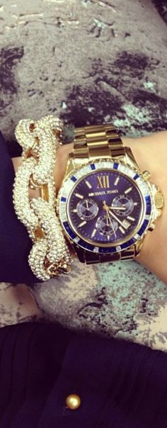 Michael Kors watch. I think the bracelet is J Crew.