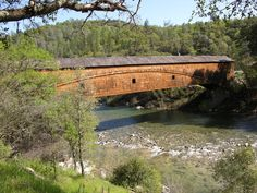"""This Covered Bridge is the longest single span in existence. EST 1862. The Bridge crosses the S. Fork of the Yuba River and is located near Nevada City, CA. In the heart of the gold country's """"Mother Lode""""."""
