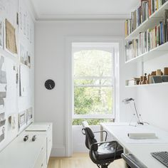 The office of Brent Allen Buck's finished renovated Brooklyn brownstone. Love how light and airy the room is. It also makes the books on the shelves really pop. Click through for more images of this Brooklyn renovation.