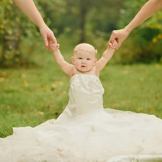 Playing in mommy's wedding dress!