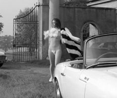 Mrs. Peel, Diana Rigg, leaves what must have been a fabulous party.