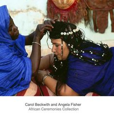 Africa | A Guedra dancer's hair is embellished with precious beads and shells. Mauritania. | ©Carol Beckwith and Angela Fisher