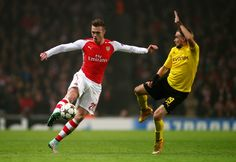 Calum Chambers of Arsenal controls the ball as Marcel Schmelzer of Borussia Dortmund closes in during the UEFA Champions League Group D match between Arsenal and Borussia Dortmund at the Emirates Stadium on November 26, 2014 in London, United Kingdom.