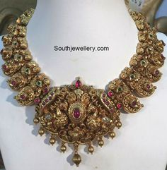 Antique finish peacock mango nakshi necklace studded with rubies and emeralds. Collier Antique, Mango Necklace, Necklace Set, Gold Jewellery Design, Gold Jewelry, Handmade Jewellery, Gold Necklaces, Antique Jewellery, Antique Necklace