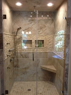 Accent tile from vanity wall used in shower Tile Details by PAGE