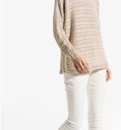 [curved, ribbed side seams] -- SWEATER WITH HORIZONTAL CABLE STITCHING