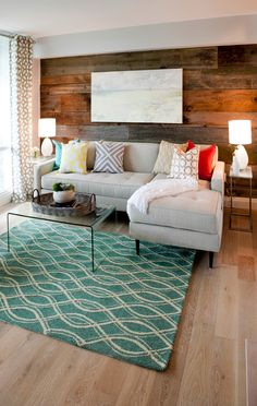 Property brothers living room with sectional and wood wall