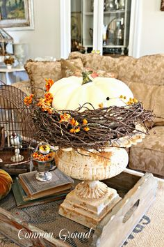 Fall Decorating - stacked books, a rusty vintage urn and a rustic wood tray come together to create a unique fall arrangement - via Common Ground