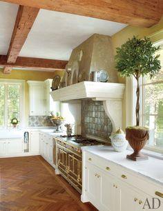 The kitchen backsplash is sheathed in antique Italian tiles from Michael Trapp; the range is by La Cornue.