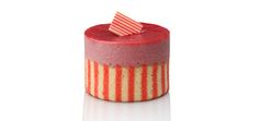Raspberry mousse, pink and white striped biscuit, raspberry glaze, striped chocolate square.