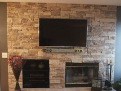 Ledge Stone Fireplace with TV. Project located in Round Lake, IL. Stone veneer was installed over existing drywall. Ledge Stone Style is our Mountain Stack Style Stone.  www.northstarstone.biz  Call 847-996-6850