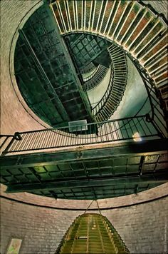 Inside lighthouse. Fresnel lens assembly at the bottom. Spiral stairs up the way. | Flickr - Photo Sharing! South Carolina