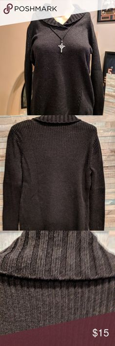 Black/Grey sweater 🤶🏻3 for $15 This sweater is a dark grey almost black. It has a rolled collar and a decorative design in the knit. It is a medium weight and tunic length. Looks great with jeans or leggings. Coldwater Creek Sweaters