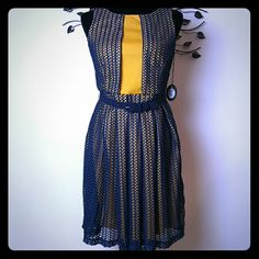 Eva Franco Anthrolologie Dress Size 4 Wonderfully unique dress to fit your style! Navy blue over yellow underlay Size 4 4th picture is a different color but stock so you can see how it fits! Eva Franco Dresses
