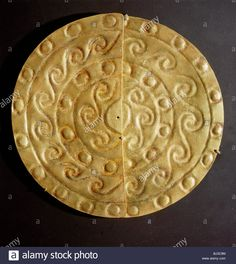 A pair of perforated embossed gold half-discs, Mochica, north coastal Peru, 100-600. Artist: Werner Forman Stock Photo