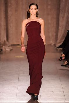 This dress is a show stopper without showing an immense amount of skin. The muted burgandy color, the subtle slashes and cuts and the hemline. Perfecto.